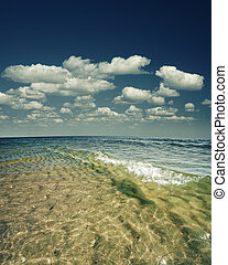 Beauty marine landscape with sea surface, waves and blue skies