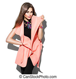 Beauty model girl posing in fashionable clothes