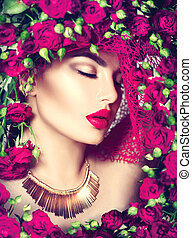Beauty model girl with pink roses flower wreath and fashion make up. Flowers hairstyle