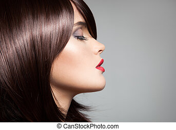 Beauty model with perfect long glossy brown hair. Close-up portr
