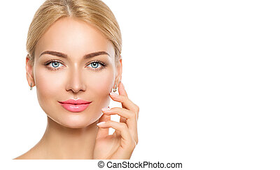 Beauty model woman face. Beautiful spa girl touching her face