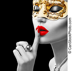 Beauty model woman wearing venetian masquerade carnival mask...