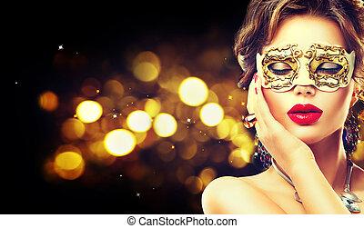 Beauty model woman wearing venetian masquerade carnival mask...