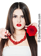 Beauty Model Woman with Long Brown Healthy Hair. Professional Makeup. Red Lips and Red Manicure
