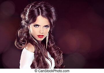 Beauty Model Woman with Professional Makeup. Hairstyle. Stylish Haircut. Fringe. Glossy Curly Hair. Extensions. Fashion Girl. Hair Coloring