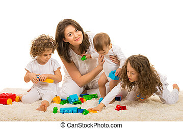 Beauty mom playing with her kids home and sitting together...