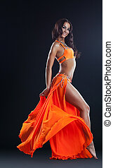 beauty naked woman posing in orange veil