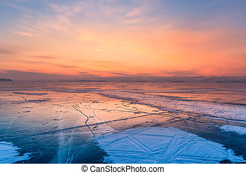 Beauty of after sunset sky over frozen water lake