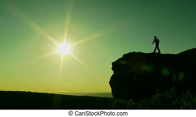 Beauty of nature - Silhouette. A man approaches the edge of...
