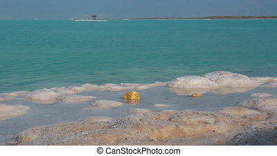 Beauty of nature with Dead Sea waterscape and salt beach -...