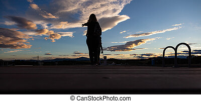 Mother and child and at sunset over mountain range, white clouds, banner, wallpaper.