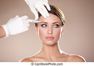 Beauty on blue background - Beautiful woman gets botox...