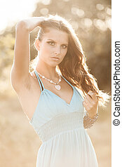 Beauty outdoor portrait of attractive young woman