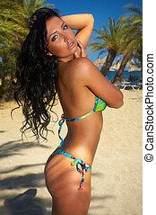 Beauty & Palms - Beautiful young Sexy woman in bikini during...