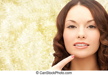 beautiful young woman pointing finger to her chin - beauty, ...