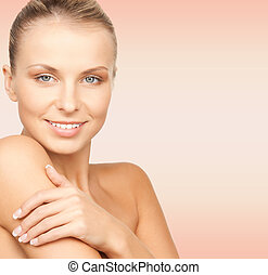 beauty, people and health concept - beautiful young woman with bare shoulders over pink background