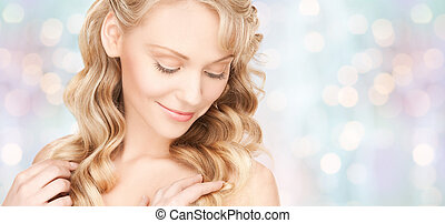 beautiful young woman face with long wavy hair - beauty,...