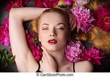 peony flowers - Beauty portrait. Beautiful blonde woman with...
