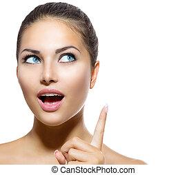 Beauty Portrait. Beautiful Spa Girl showing Finger Up