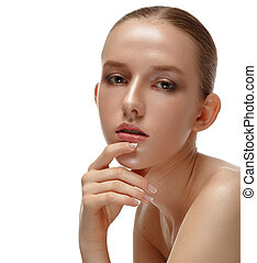 Beauty Portrait. Beautiful Woman Touching her Face. Perfect Fresh Skin. Isolated on White Background. Pure Beauty Model. Youth and Skin Care Concept