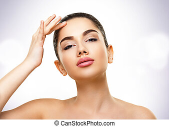 Beauty Portrait. Face of Beautiful Young Woman with Perfect Skin