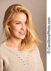 Beauty portrait of a cute blonde woman