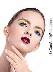 beauty portrait of a girl with a bright make-up