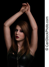 Beauty portrait of a sensual woman on black background