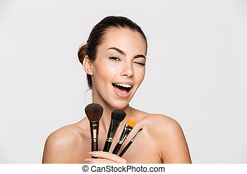 Beauty portrait of an excited beautiful half woman