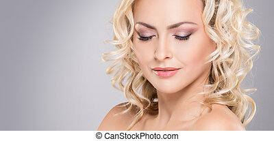 Beauty portrait of attractive blond woman with curly hair...