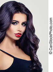 Beauty Portrait of Beautiful Brunette Woman with Curly Hair and Red Lips Makeup