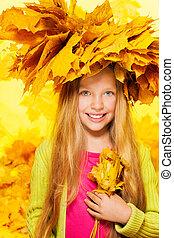 Beauty portrait of blond girl in maple crown