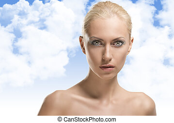 beauty portrait of blonde girl in front of the camera