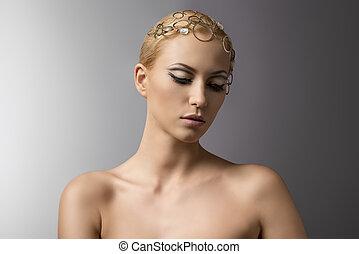 beauty portrait of blonde girl looks down