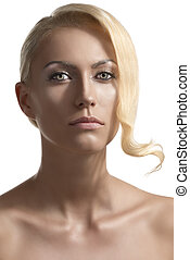 beauty portrait of blonde girl looks in to the lens