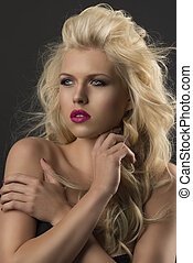 beauty portrait of blonde girl with crossed arms
