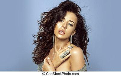 Beauty portrait of brunette woman in earrings.