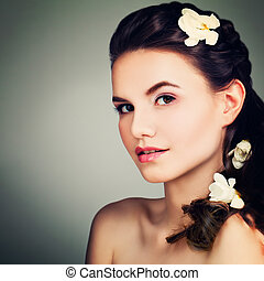 Beauty Portrait of Perfect Brunette Model Woman with Prom Hairstyle, Makeup and Flowers