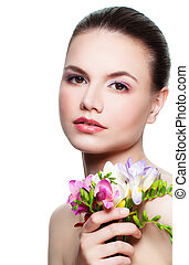 Beauty Portrait of Perfect Woman. Cute Face and Flowers Isolated