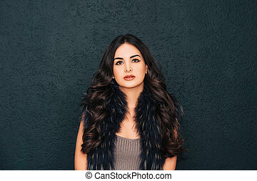 Beauty portrait of pretty young woman with bright makeup and long black hair