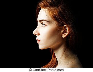 Beauty portrait of redhead woman.