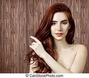 Beauty portrait of redhead woman with perfect skin.