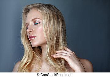 Beauty portrait of sensitive nordic natural blonde woman