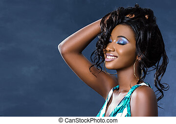 Beauty portrait of sensual african woman touching hair.