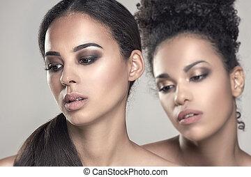 Beauty portrait of two african american girls.