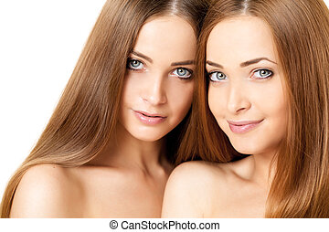 Beauty portrait of two beautiful young women
