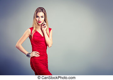 Beauty Portrait of Woman in Red on Gray Backgound