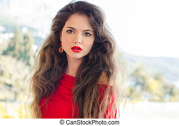 Beauty portrait of young attractive woman with red lips and long