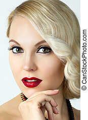 Beauty portrait of young blonde woman with retro style make-up