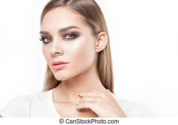 Beauty portrait of young girl with makeup.